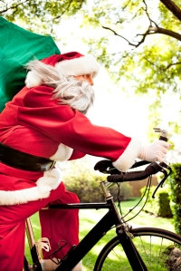 Santa racing on a bicycle