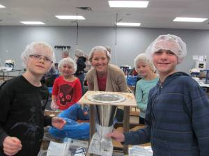 "Feed My Starving Children has unique ""helmets"" for service"