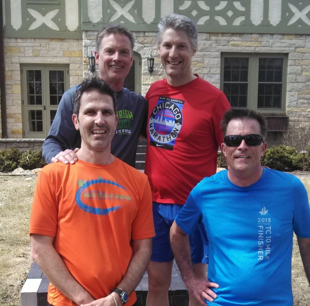 Dan and Mike stand behind fellow runners Bob and Gary.  All four have run Boston in recent years.