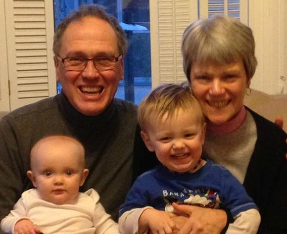 My wife Carolyn and I hold in our laps two children of God, Grace and Jack.