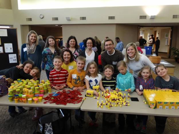 Families make school kits during Faith In Action Sunday